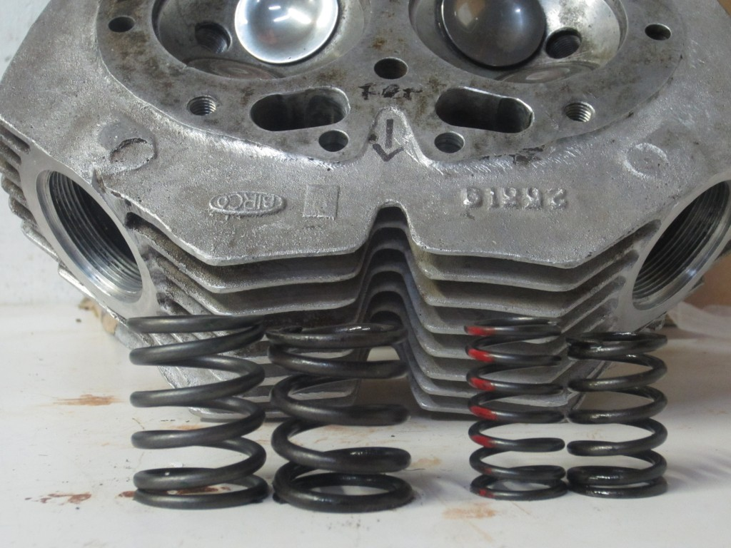 The original valve springs with a substantial amount of metal fatigue are the shorter set. Even the material of the springs is of a much greater quality than was available forty-eight years ago.